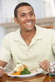 Man Enjoying A Meal At Home Stock Photo