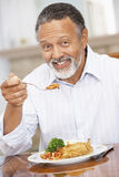 Man Enjoying A Meal At Home Stock Image
