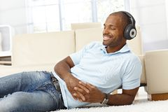 Man enjoying music on headphones Stock Photo