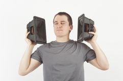 Man enjoying music from loudspeaker Royalty Free Stock Images