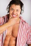 Man Enjoying Music over natural  background Royalty Free Stock Images
