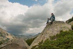 Man Enjoying Nature on a Mountain Stock Photo