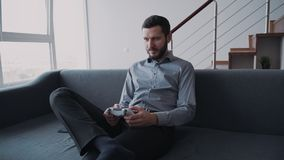 Man is enjoying new digital technology by playing in playstation. stock footage