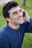 Man enjoying phone call smiling happy succes. Handsome man happy talking on his cell phone smiling royalty free stock photography