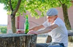Man enjoying a quiet drink outdoors Stock Photos