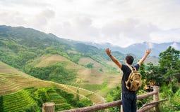 Man enjoying rice terrace scenery. Girl enjoying stunning rice terraced field scenery stock images