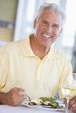 Man Enjoying Salad Stock Photo