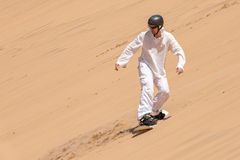 Man enjoying sandboarding Royalty Free Stock Photos