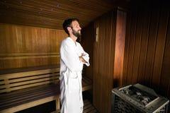 Man enjoying sauna health benefits Royalty Free Stock Photography