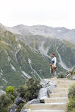 A man enjoying scenic view along the walking trail to the Blue Lakes and Tasman Glacier View, Aoraki / Mount Cook National Park Stock Photos