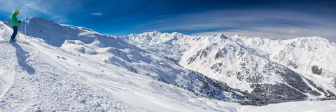 Man enjoying the stunning view before freeride skiing in famous. Man enjoying the stunning  before freeride skiing in famous ski resort in Tyrolian Alps Royalty Free Stock Image