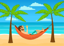 Man enjoying summer time holidays, vacations, lying in hammock under palm trees Stock Images