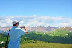 Man enjoying time  on hiking trip in mountains. Royalty Free Stock Photos