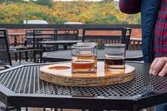 Man enjoying a variety of seasonal craft beer stock photos