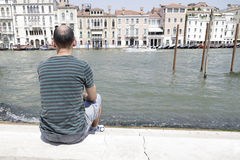 Man enjoying the view of the Grand Canal, Venice. Man enjoying the view of the different palaces on the Grand Canal, Venice, Italy Stock Photo