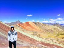 A man enjoying the view of the incredible Rainbow Mountains outs royalty free stock photo