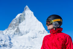 Man enjoying the view over the beautiful landscape of winter mountains. Matterhorn. Swiss. Winter vacation Royalty Free Stock Photo