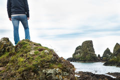Man enjoying the view. Man standing on a rock overlooking landscape Stock Images