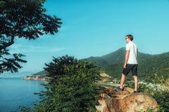 Man enjoying view on top of mountain Royalty Free Stock Images
