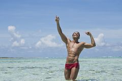 Man enjoying in water on the beach. Happy man enjoying on the beach Royalty Free Stock Images