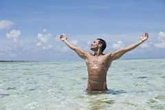 Man enjoying in water on the beach. In the water Stock Image