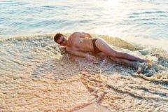 Man enjoying in water on beach Royalty Free Stock Images
