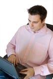 Man enjoying work on laptop Stock Images