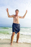 Man enjoys the beautiful sandy beach Royalty Free Stock Photography