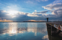 Man enjoys the spectacular sky over Lake Veere Stock Images