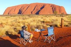 Man enjoys the spectacular sunset of Uluru Ayers Rock Royalty Free Stock Image
