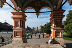An man enjoys the view of Red Square from St. Basils cathedral Stock Photo