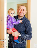 Man entering in  apartment with daughter Stock Photography