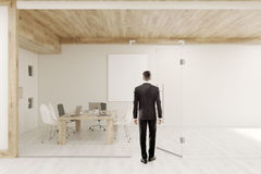 Man entering conference room with glass walls and doors Royalty Free Stock Images