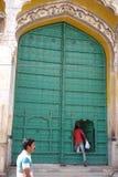Man Entering Large Door Royalty Free Stock Image