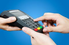 Man entering PIN on payment terminal. Man entering security code on payment terminal Royalty Free Stock Images