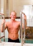 Man Entering Spa Pool royalty-vrije stock foto's
