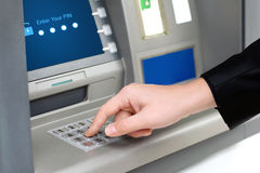Man enters a PIN code and withdraws money from an ATM Royalty Free Stock Images