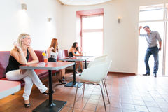 Man enters restaurant with three Royalty Free Stock Photos