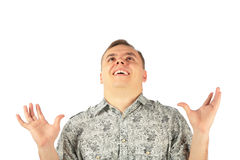 Man in enthusiasm looks upward with hads up. On white stock photo
