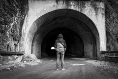 Man entry in a tunnel Royalty Free Stock Photos