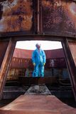 Man environment mask dark facemask icon protective overall blue orange rast factory disused catastrophe chernobyl. Men in blue protective overall on lost soviet stock images