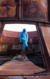Man environment mask dark facemask icon protective overall blue orange rast factory disused catastrophe chernobyl. Men in blue protective overall on lost soviet royalty free stock photography