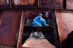Man environment mask dark facemask icon protective overall blue orange rast factory disused catastrophe chernobyl. Men in blue protective overall on lost soviet stock photos