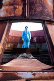 Man environment mask dark facemask icon protective overall blue orange rast factory disused catastrophe chernobyl. Men in blue protective overall on lost soviet stock photography