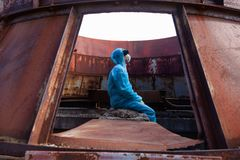 Man environment mask dark facemask icon protective overall blue orange rast factory disused catastrophe chernobyl. Sad man in blue protective overall on lost stock photography