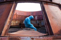 Man environment mask dark facemask icon protective overall blue orange rast factory disused catastrophe chernobyl. Sad man in blue protective overall on lost stock photo