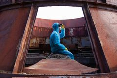 Man environment mask dark facemask icon protective overall blue orange rast factory disused catastrophe chernobyl. Sad man in blue protective overall on lost stock images