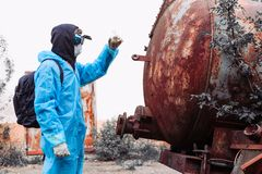 Man environment mask drum pack disguise facemask water muddy protective overall blue rast plant factory disused catastrophe. Men in blue protective overall at stock images