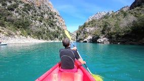 Kayaking in Verdon Canyon in springtime, Provence. France. Man eploring Verdon Canyon in kayak. Provence. France stock video
