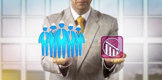 Man Equating Blue Collar Worker Team With Failure. Unrecognizable HR manager is equating a team of five blue collar workers with a downward trend icon. HRM Royalty Free Stock Photo